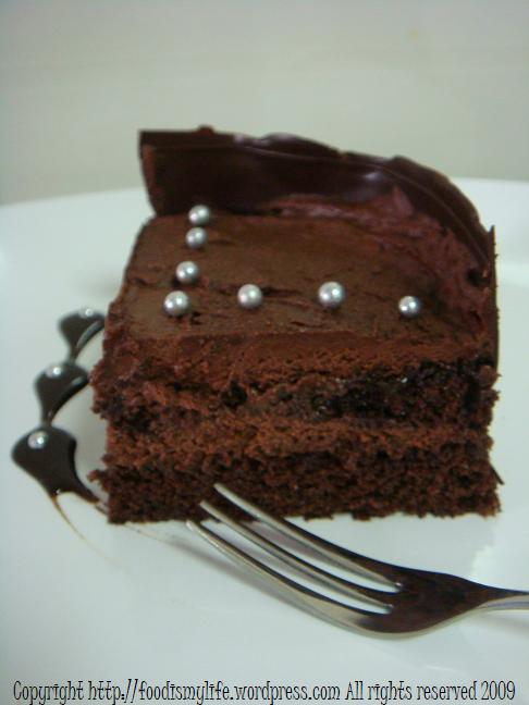 Chocolate cake with chocolate collar - slice